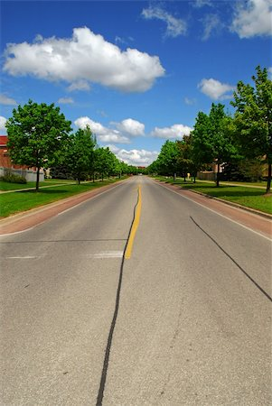Empty residential street in suburban neighborhood lined with trees Stock Photo - Budget Royalty-Free & Subscription, Code: 400-04499036