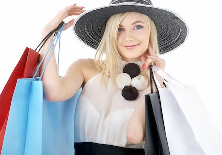 elegant blond in retro hat with shopping bags Stock Photo - Budget Royalty-Free & Subscription, Code: 400-04499042