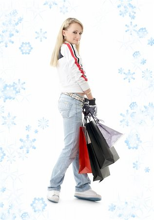 teenage girl with shopping bags and snowflakes Stock Photo - Budget Royalty-Free & Subscription, Code: 400-04490155