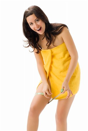fat italian woman - pretty young brunette wearing a yellow towel and measuring her legs making funny face Stock Photo - Budget Royalty-Free & Subscription, Code: 400-04491607