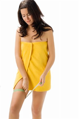 fat italian woman - pretty young brunette wearing a yellow towel and measuring her legs making funny face Stock Photo - Budget Royalty-Free & Subscription, Code: 400-04491608
