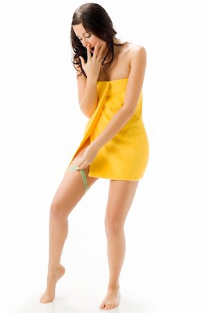 fat italian woman - pretty young brunette wearing a yellow towel and measuring her legs making funny face Stock Photo - Budget Royalty-Free & Subscription, Code: 400-04491603