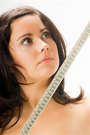 fat italian woman - nice portrait of a young brunette looking at the tape measure with surprise Stock Photo - Budget Royalty-Free & Subscription, Code: 400-04491611