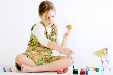preteen girl feet - Studio portrait of a young blond girl who is playing with paint and eggs for easter Stock Photo - Budget Royalty-Free & Subscription, Code: 400-04493774