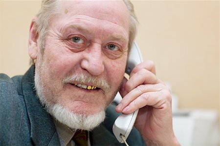 Mature businessman talking on the phone, Stock Photo - Budget Royalty-Free & Subscription, Code: 400-04504842