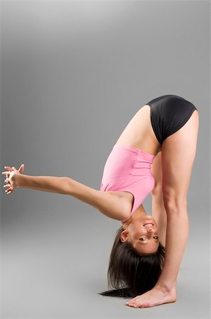 feet gymnast - cute gymnast stretching her body before a competition Stock Photo - Budget Royalty-Free & Subscription, Code: 400-04506031