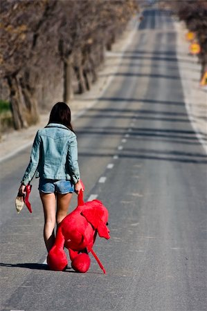 running away scared - Young woman lefted behind with her teddy bear. Stock Photo - Budget Royalty-Free & Subscription, Code: 400-04502562