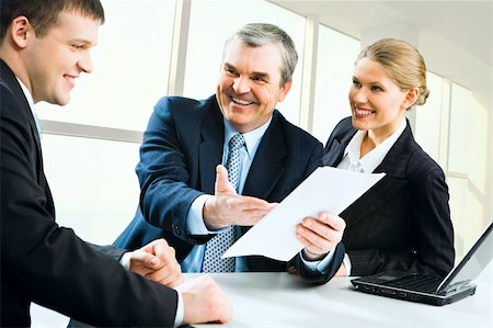 Image of senior boss giving business instructions to man and pretty secretary standing near by Stock Photo - Budget Royalty-Free & Subscription, Code: 400-04518742