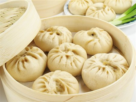 dumplings steamer - Baozi are steamed buns filled with ground meat and cabbage. Stock Photo - Budget Royalty-Free & Subscription, Code: 400-04527143