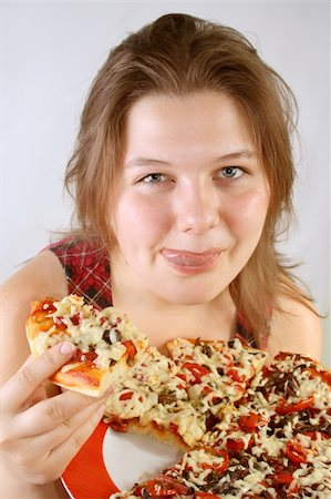 fat italian woman - Beautiful no make-up girl eating a piece of Pizza Stock Photo - Budget Royalty-Free & Subscription, Code: 400-04527580