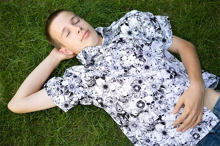 happy boy lying on grass Stock Photo - Budget Royalty-Free & Subscription, Code: 400-04527763