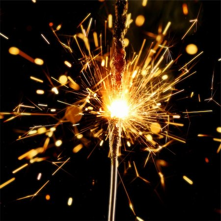 christmas sparkler firework flame on black Stock Photo - Budget Royalty-Free & Subscription, Code: 400-04527824