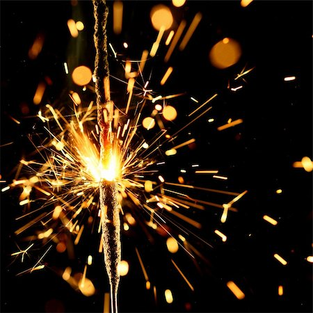 red colour background with white fireworks - christmas sparkler firework flame on black Stock Photo - Budget Royalty-Free & Subscription, Code: 400-04527863