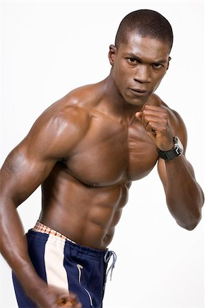 skinny man muscle pose - African American Athlete shows some muscle Stock Photo - Budget Royalty-Free & Subscription, Code: 400-04529309