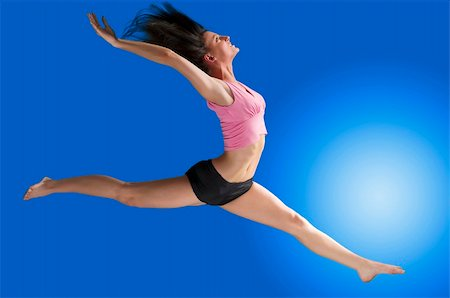 feet gymnast - a cute gymnast in a hard jump on a blue background Stock Photo - Budget Royalty-Free & Subscription, Code: 400-04520237