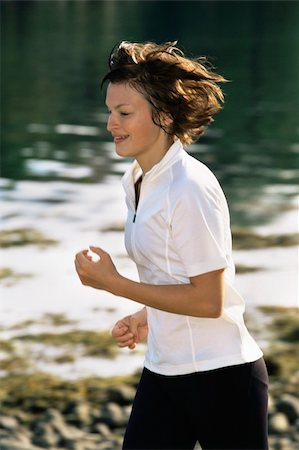 sweaty woman - Young woman running along water's edge Stock Photo - Budget Royalty-Free & Subscription, Code: 400-04535435