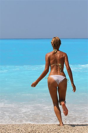 simsearch:400-04002563,k - Pretty blonde woman enjoying the Ionian sea in Greece Stock Photo - Budget Royalty-Free & Subscription, Code: 400-04537610