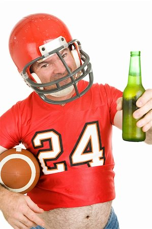 fat man balls - Middle aged football fan wearing his old uniform and having a beer.  White background. Stock Photo - Budget Royalty-Free & Subscription, Code: 400-04538316