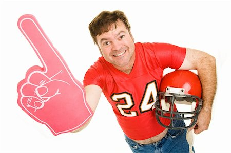 Enthusiastic middle aged football fan wearing his old high school jersey and holding a helmet and a foam finger.  Isolated on white. Stock Photo - Budget Royalty-Free & Subscription, Code: 400-04539614