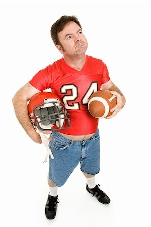 Football fan in his old high school jersey, remembering the good old days.  Full body isolated on white. Stock Photo - Budget Royalty-Free & Subscription, Code: 400-04539612