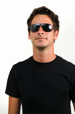 Portrait of young trendy man wearing sunglasses isolated Stock Photo - Budget Royalty-Free & Subscription, Code: 400-04539818