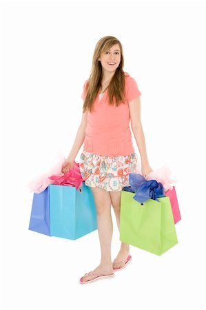 Beautiful Caucasian teenager holding shopping bags while standing on a white background Stock Photo - Budget Royalty-Free & Subscription, Code: 400-04532252