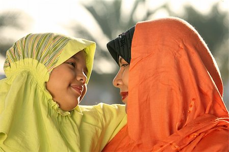 daughter kissing mother - Muslim mother and child   looking at each other Stock Photo - Budget Royalty-Free & Subscription, Code: 400-04546085