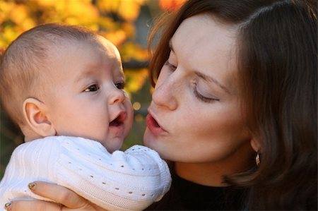 daughter kissing mother - Mother holding child Stock Photo - Budget Royalty-Free & Subscription, Code: 400-04547354