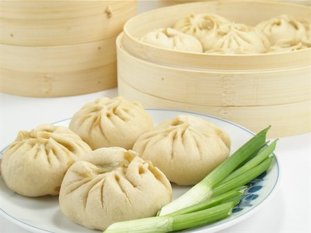 dumplings steamer - Baozi are steamed buns filled with ground meat and cabbage. Stock Photo - Budget Royalty-Free & Subscription, Code: 400-04547880