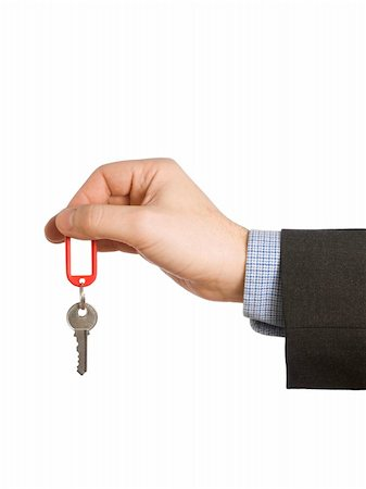 simsearch:400-05936191,k - A hand holding a red keyring with a blank label and a key. Stock Photo - Budget Royalty-Free & Subscription, Code: 400-04549555