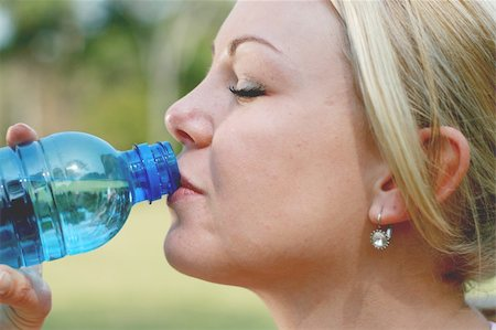 sweaty woman - blond woman drink water after fitness workout Stock Photo - Budget Royalty-Free & Subscription, Code: 400-04549875