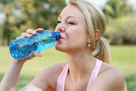 sweaty woman - blond woman drink water after fitness workout Stock Photo - Budget Royalty-Free & Subscription, Code: 400-04549876
