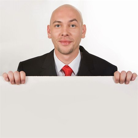 skinhead - Photo of smiling male behind partition looking at camera Stock Photo - Budget Royalty-Free & Subscription, Code: 400-04540207