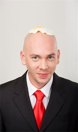 skinhead - Portrait of smiling male with omelet on top of bald head Stock Photo - Budget Royalty-Free & Subscription, Code: 400-04540213