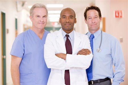 Doctors Standing In A Hospital Corridor Stock Photo - Budget Royalty-Free & Subscription, Code: 400-04543644