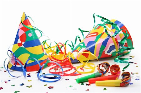 party celebration paper confetti - Party hats, paper streamer and whistles isolated on white background Stock Photo - Budget Royalty-Free & Subscription, Code: 400-04555015
