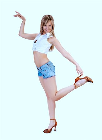 long legged cute blond girl in blue jeans shorts on white Stock Photo - Budget Royalty-Free & Subscription, Code: 400-04559312