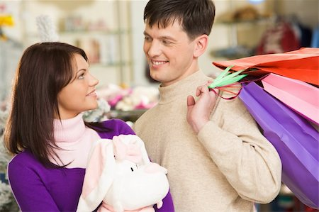 Photo of handsome man looking at his wife during shopping in trade center Stock Photo - Budget Royalty-Free & Subscription, Code: 400-04550735