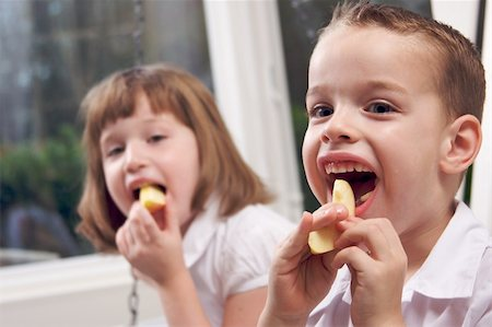 pre-teen boy models - Sister and Brother Having Fun Eating an Apple Stock Photo - Budget Royalty-Free & Subscription, Code: 400-04552624