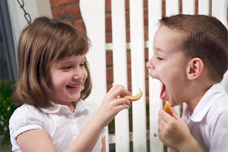pre-teen boy models - Sister and Brother Having Fun Eating an Apple Stock Photo - Budget Royalty-Free & Subscription, Code: 400-04552625
