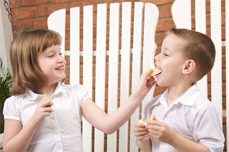 pre-teen boy models - Sister and Brother Having Fun Eating an Apple Stock Photo - Budget Royalty-Free & Subscription, Code: 400-04552626