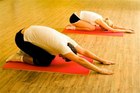 sweaty woman - Image of man and woman doing physical exercises on mats in the sports club together Stock Photo - Budget Royalty-Free & Subscription, Code: 400-04566149
