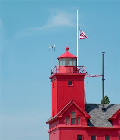 flag at half mast - American flag flying at half mast on a lighthouse. Stock Photo - Budget Royalty-Free & Subscription, Code: 400-04567805