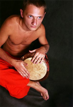 Man playing the nigerian drum in studio Stock Photo - Budget Royalty-Free & Subscription, Code: 400-04563144