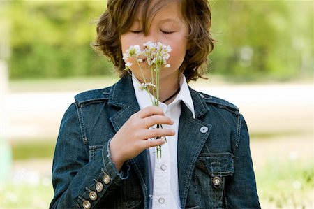 young boy is smelling on his flower Stock Photo - Budget Royalty-Free & Subscription, Code: 400-04563250