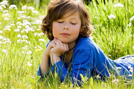 Young boy is thinking in the grass Stock Photo - Budget Royalty-Free & Subscription, Code: 400-04563252
