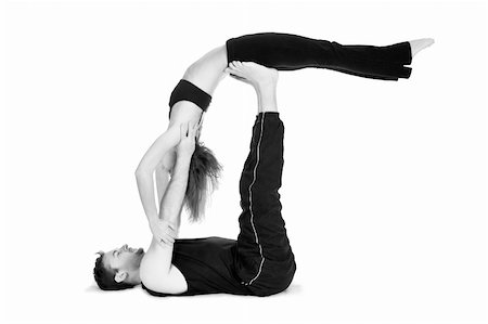 skinny man muscle pose - Male and female gymnasts practicing a complex double yoga pose. Stock Photo - Budget Royalty-Free & Subscription, Code: 400-04563360