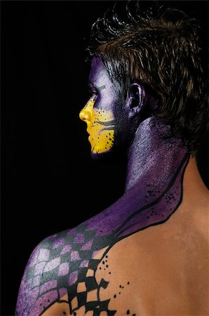 Portrait of young model wearing artistic bodypaint drawing Stock Photo - Budget Royalty-Free & Subscription, Code: 400-04574537