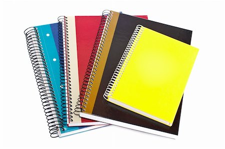 Some notebooks isolated on white background. Shallow depth of field Stock Photo - Budget Royalty-Free & Subscription, Code: 400-04574605