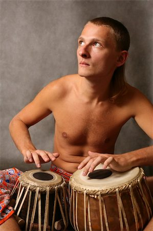Man playing the nigerian drum in studio Stock Photo - Budget Royalty-Free & Subscription, Code: 400-04572769